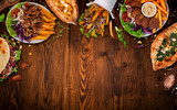 Top down view on traditional turkish meals on vintage wooden table. - 222940108