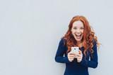 Vivacious young woman laughing at a good joke - 222947173