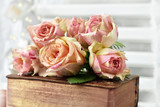 bunch of multicolor roses lying on old book - 222948587
