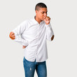 Young african american man is suffering with cough and feeling bad on grey background