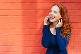 Laughing woman holding smart phone to her ear - 222950163