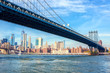 The Manhattan Bridge with  Manhattan in the background at the day-time, New York City, United States. - 222951141