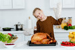 adorable little child with thanksgiving turkey on tray