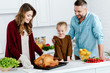 beautiful little child preparing thanksgiving dinner with parents