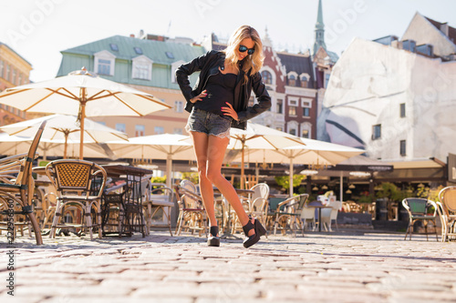 Stylish woman wearing shorts and high heels - 222956360