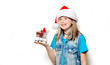 portrait of young teenage girl in Christmas hat with supermarket cart on white background