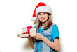 portrait of young teenage girl in Christmas hat with gift box on white background