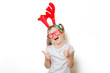 Portrait of an emotional toddler girl in Christmas deer horns on white background