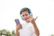 Happy boy listening to his smartphone