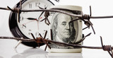 Economic warfare, sanctions and embargo busting concept. US Dollar money wrapped in barbed wire. - 222980301