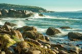 Morning on the Atlantic coast. National Park of Acadia.US. Maine. Beautiful stony coast and forests on the islands in the distance.  - 222982544