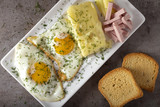Fried eggs with melted Romanian cheese called cas and some parizer - 222983523
