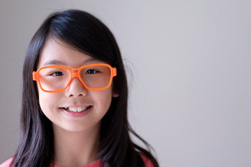 Portrait of Asian teenager girl with big orange glasses