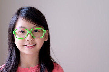 Portrait of Asian teenager girl with big green glasses