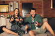 Young Couple Playing Video Game Together at Home