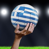 Man holding Soccer ball with Greek flag - 222993142
