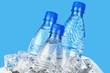 Leinwanddruck Bild - Three Bottles of Water in Ice Bucket on the Blue Background