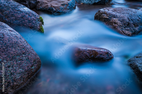 The water flow or stream running to the gulf of the sea among the rocks and stones  - 222996791