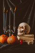 pumpkins, skull and halloween decor on black cloth