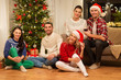 celebration and holidays concept - happy friends having christmas party together at home