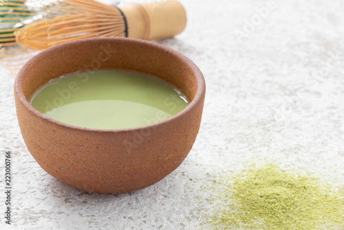green tea latte in Japan cup with tea whisk for matcha
