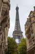 Leinwanddruck Bild - View of Eiffel Tower through the ancient buildings in Paris, France