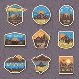 Set of nine mountain travel emblems. Camping outdoor adventure emblems, badges and logo patches. Mountain tourism, hiking. Forest camp labels in vintage style