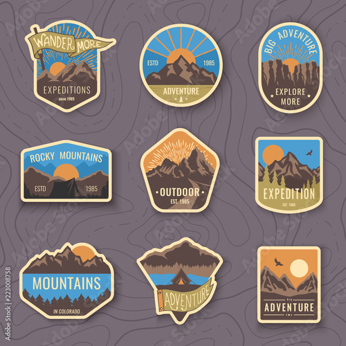 Set of nine mountain travel emblems. Camping outdoor adventure emblems, badges and logo patches. Mountain tourism, hiking. Forest camp labels in vintage style - 223008758