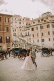 Young wedding couple near Spanish steps (Scalinata di Trinità dei Monti) in Rome, Italy - 223008996