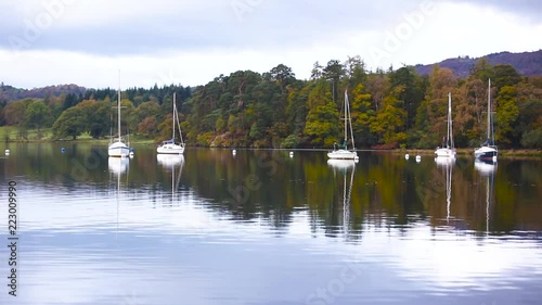 Sailing boats and trees reflections on the water