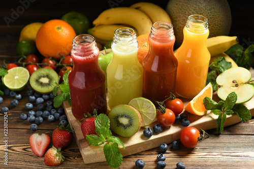 Fototapeta Various fresh fruits and vegetables smoothies in bottles