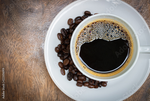 fresh black coffee top view on wood table