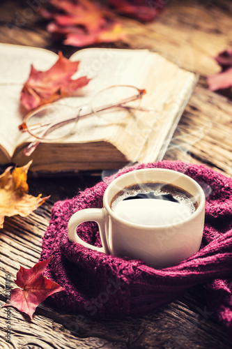 Cup of coffee old  book glasses and autumn leaves. - 223018115