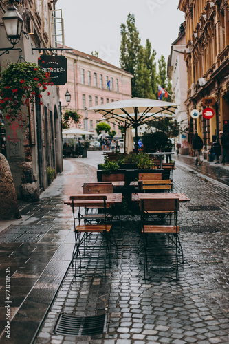 Fototapeta Beautiful streets after the rain of a European city with old architecture