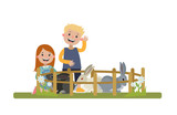 Young boy and girl on the farm