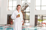 Delicious drink. Happy positive woman holding her tasty cocktail while being in the swimming pool - 223026962