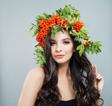 Woman in wreath. Female model with healthy skin, curly hairstyle, natural makeup. Haircare concept