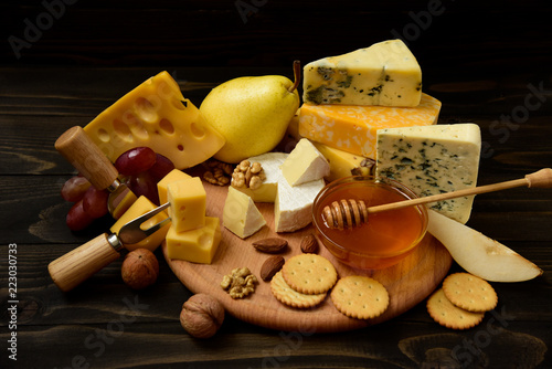 Fototapeta slices of cheese brie or camembert with croissants