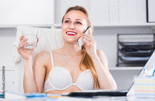Portrait of smiling girl in underwear in the office