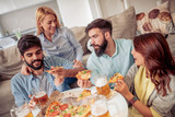 Friends eating pizza - 223046331