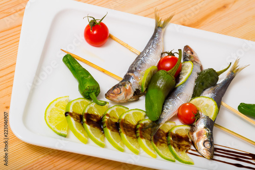 Sprats grilled with fresh vegetables - 223046907