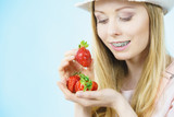 Young woman with fresh strawberries - 223050364