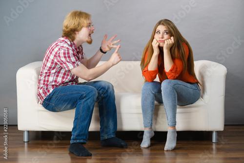 Bored woman and angry man