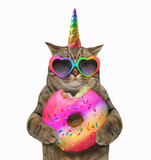 The cat unicorn is eating a big bitten rainbow donut White background. - 223051365