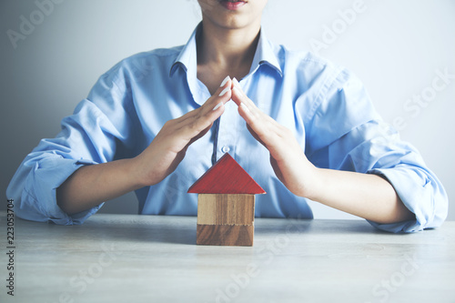 woman  holding a model of a house