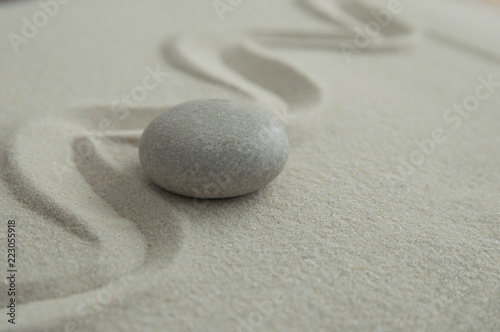 Pyramids of gray zen stones on the sand with wave drawings. Concept of harmony, balance and meditation, spa, massage, relax - 223055918
