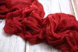 Red fabric on a white table - 223061174