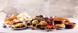 Middle eastern or arabic dishes and assorted meze, concrete rustic background. sambusak. Turkish Dessert Baklava with pistachio. Sarma. Halal food. Lebanese - 223063590
