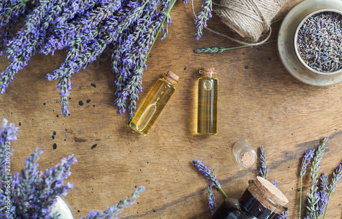 lavender oil bottles,  natural herb cosmetic consept with lavender flowers flatlay on stone background - 223069372