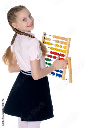 The girl counts on abacus - 223070779
